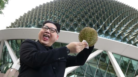 A Kim Jong Un impersonator, Howard X, poses with a durian at the Esplanade on May 27, 2018 in Singapore.