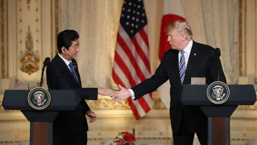 U.S. President Donald Trump and Japanese Prime Minister Shinzo Abe shake hands at a news conference at Mar-a-Lago resort on April 18, 2018.