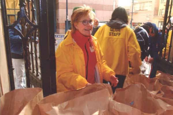 Susie Buffett volunteering during GLIDE's free Grocery Bag Giveaway during the holidays.