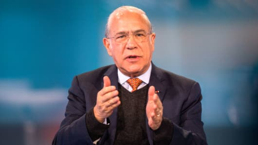Jose Angel Gurria, secretary-general of the Organization for Economic Cooperation and Development (OECD), gestures as he speaks during a Bloomberg Television interview in London on Wednesday, April 4, 2018.