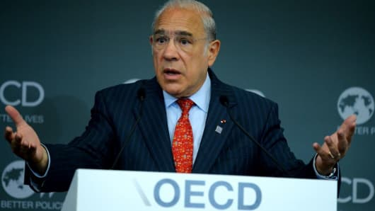 Organisation for Economic Co-operation and Development (OECD) General Secretary Angel Gurria gestures as he addresses a meeting at OECD headquarters in Paris on June 7, 2017.