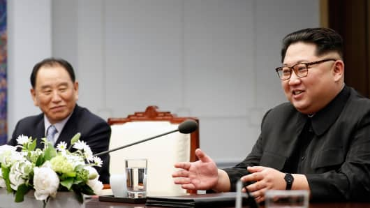 North Korea's leader Kim Jong Un (R) speaks with South Korea's President Moon Jae-in (unseen) as North Korean General Kim Yong Chol (L), who is in charge of inter-Korean affairs for North Korea&#0   39;s ruling Workers' Party, looks on during the inter-Korean summit in the Peace House building on the southern side of the truce village of Panmunjom on April 27, 2018.