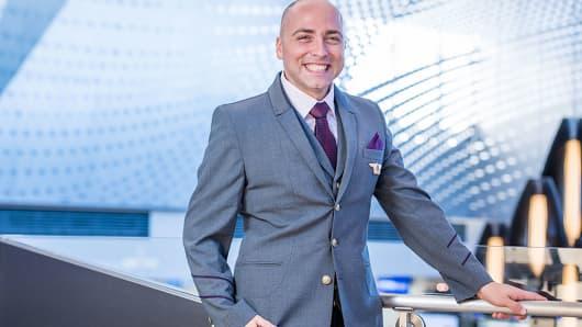 Delta Airlines unveils new male flight attendant uniform.