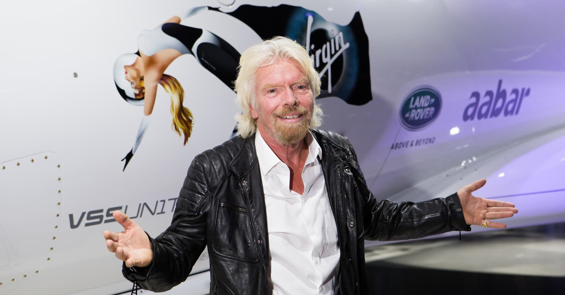 Sir Richard Branson in front of Virgin Galactic's Unity spacecraft