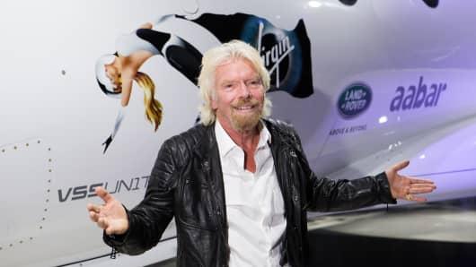 Sir Richard Branson in front of Virgin Galactic's Unity spacecraft