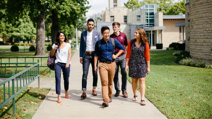 Students walk on the College of the Ozarks campus.