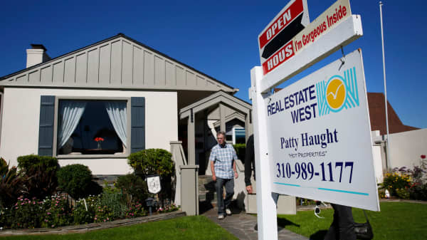 Potential homebuyers exit an open house in Redondo Beach, California.