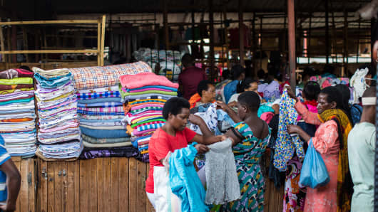 Shoppers at Nyamirambo Market in the Rwandan capital of Kigali sift through piles of used clothing on May 10, 2018.