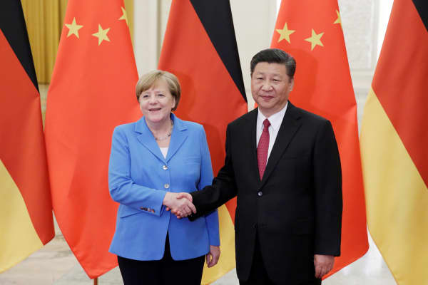 China's President Xi Jinping (R) meets German Chancellor Angela Merkel at the Great Hall of the People in Beijing, China, May 24, 2018.