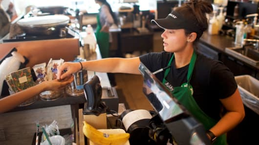 A Starbucks barista fulfills an order in a South Philadelphia store.