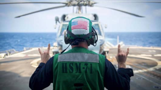 A U.S. helicopter from the Helicopter Maritime Strike Squadron Seven One lands on a Navy vessel.