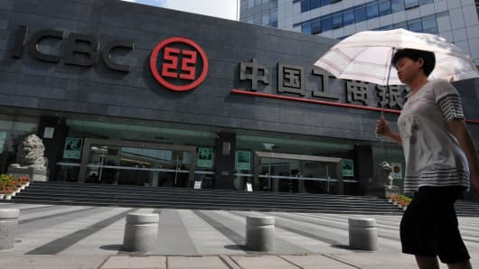 A citizen walks pass a branch of Industrial & Commercial Bank of China (ICBC) in Fuzhou, Fujian province of China.