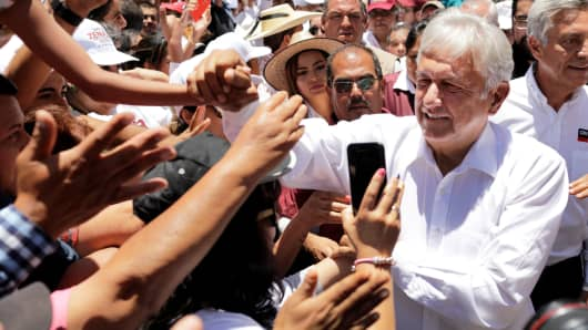 Leftist front-runner Andres Manuel Lopez Obrador of the National Regeneration Movement (MORENA) is greeted by supporters while arriving to a campaign rally in Zitacuaro, Mexico May 28, 2018.