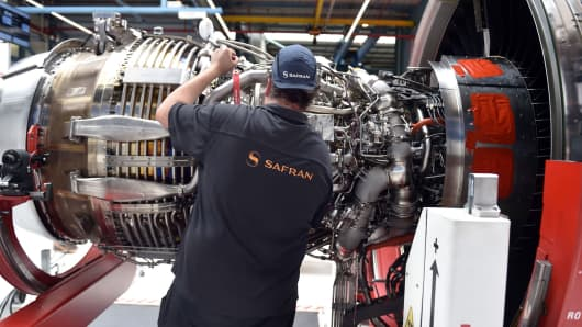 An employee works on an aircraft engine for the Airbus A320 NEO at the industrial and technological engine manufacturer French Safran plant, in Colomiers, southwestern France, on May 17, 2018.