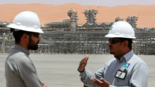 Aramco employees are seen at Natural Gas Liquids (NGL) facility in Saudi Aramco's Shaybah oilfield, Saudi Arabia.