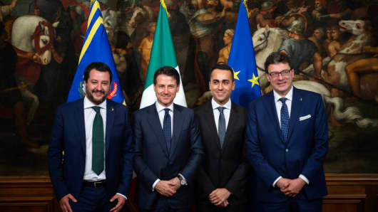 Matteo Salvini (L), Deputy Prime Minister and Italian Interior minister, Italian Prime Minister Giuseppe Conte (2L), Luigi Di Maio (2R), Deputy Prime Minister and Labor Minister, and Giancarlo Giorgetti (R) Undersecretary pose for a picture during the first cabinet meeting of the new government at the Palazzo Chigi on June 1, 2018 in Rome.