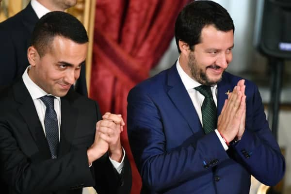 Italy's Interior Minister and deputy PM Matteo Salvini (R) and Italy's Labor and Industry Minister and deputy PM Luigi Di Maio gesture during the swearing in ceremony of the new government led by Prime Minister Giuseppe Conte at Quirinale Palace in Rome on June 1, 2018.