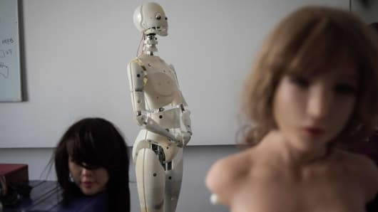Robots in a lab of a doll factory of EXDOLL, a firm based in the northeastern Chinese port city of Dalian.