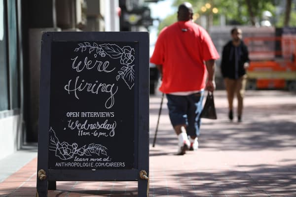 A now hiring sign is posted in front of an Anthropologie store on June 1, 2018 in San Francisco, California.