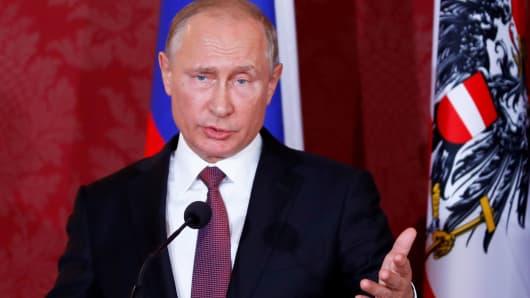 Russia's President Vladimir Putin gestures during a joint news conference with Austria's President Alexander Van der Bellen in Vienna, Austria June 5, 2018.