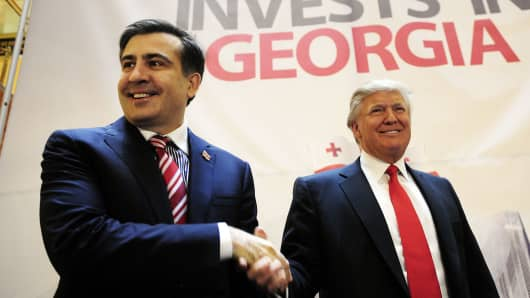 Georgia's then-President Mikheil Saakashvili (L) and Donald Trump shake hands during a press conference to announce a real estate project by Trump in Georgia, at the Trump Tower in New York, March 10, 2011.