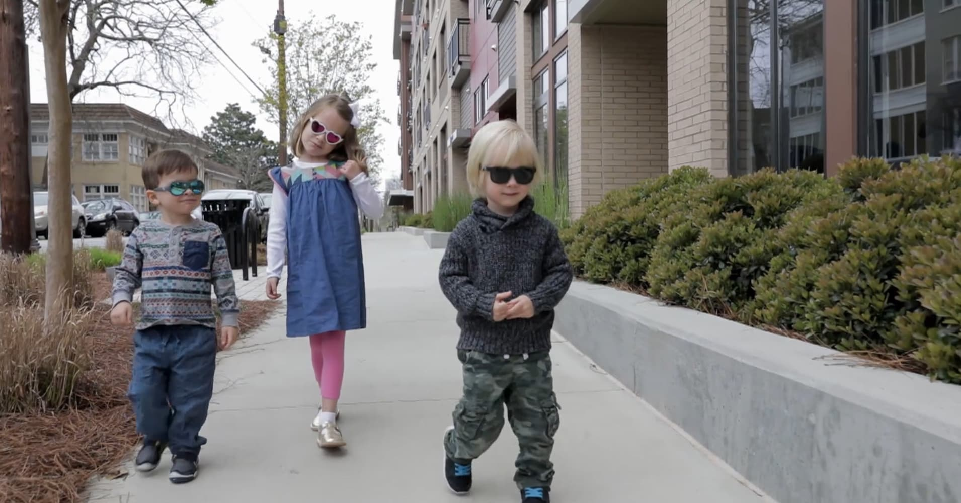 Some children try on Babiators