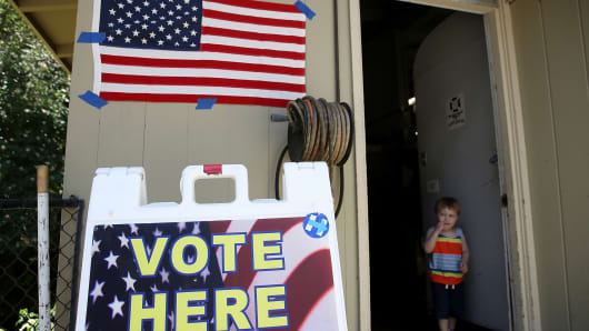 A boy stands in the doorway of a polling station on June 5, 2018 in San Anselmo, California. California voters are heading to the polls to vote in the primary election.