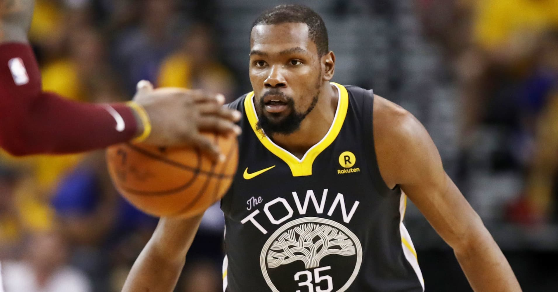 kevin-durant-35-of-the-golden-state-warriors-defends-against-lebron-james-of-the-cleveland