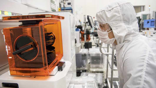 A technician checks on a stack of wafers at the Applied Materials facility in Santa Clara, California.