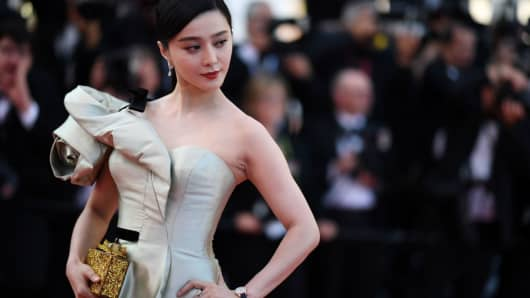 Chinese actress Fan Bingbing poses as she arrives on May 11, 2018, for a screening at the 71st edition of the Cannes Film Festival in France.