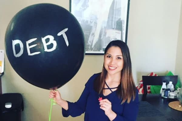 Guen Garrido became debt free in March 2018 and celebrated by popping a large balloon filled with confetti