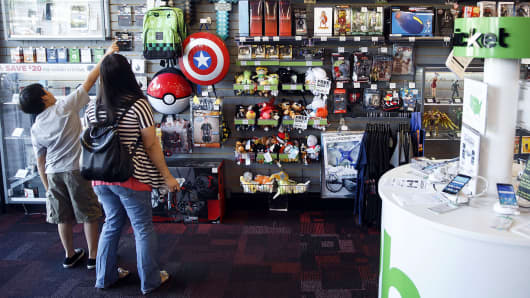 Customers browse collectible video game merchandise for sale at a GameStop Corp. store in West Hollywood, California.