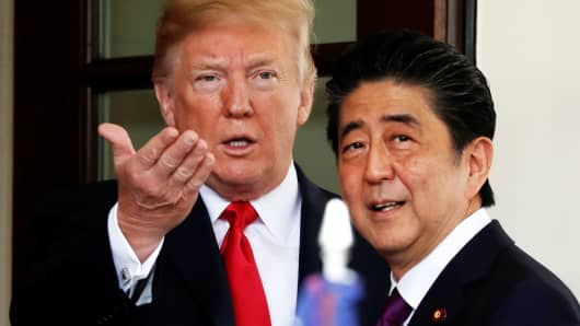 President Donald Trump welcomes Japanese Prime Minister Shinzo Abe at the White House in Washington, June 7, 2018.