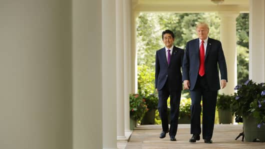 Japanese Prime Minister Shinzo Abe and U.S. President Donald Trump arrive for a joint news conference at the White House June 7, 2018.