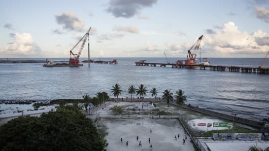A view of the China-led bridge construction project connecting the Maldives' capital island of Male to its airport island of Hulhule on October 27, 2016, in Male, Maldives.