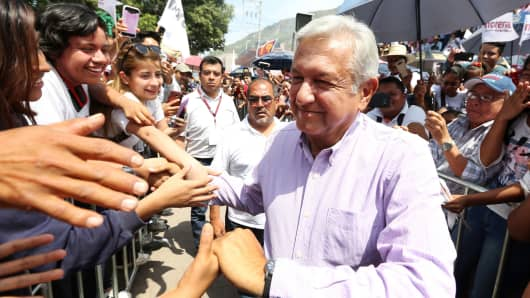 Leftist front-runner Andres Manuel Lopez Obrador of the National Regeneration Movement (MORENA) is greeted by supporters after a campaign rally in Tlapa de Comonfort, in Guerrero state, Mexico June 7, 2018.