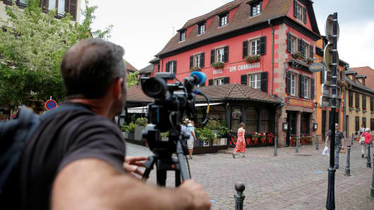 "A cameraman works outside Le Chambard Hotel in Kaysersberg-Vignoble, France, June 8, 2018. Celebrity chef Anthony Bourdain, host of CNN's food-and-travel-focused ""Parts Unknown"" television series, killed himself in a French hotel room, CNN said on June 8, 2018."