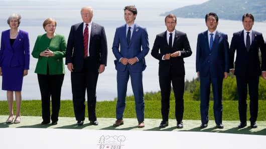 L-R: British Prime Minister Theresa May, German Chancellor Angela Merkel, U.S. President Donald Trump, Canada's Prime Minister Justin Trudeau, French President Emmanuel Macron, Japanese Prime Minister Shinzo Abe and Italian Prime Minister Giuseppe Conte pose for a family photo at the G7 Summit in the Charlevoix city of La Malbaie, Quebec, Canada, June 8, 2018.