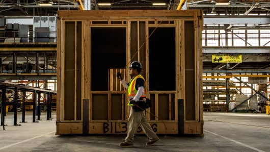 A worker walks past part of the assembly line at Factory OS in Vallejo, Calif., April 27, 2018. Developers are taking on residential building challenges by extending the concept of prefabricated housing to manufacture entire apartment buildings.