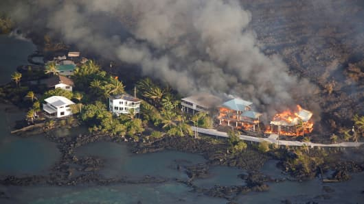 Lava destroys homes in the Kapoho area, east of Pahoa, during ongoing eruptions of the Kilauea Volcano in Hawaii.