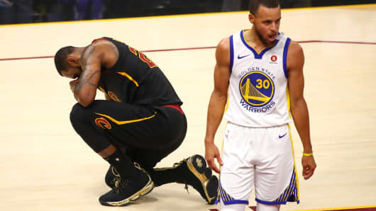 LeBron James of the Cleveland Cavaliers reacts against Stephen Curry of the Golden State Warriors during Game Four of the 2018 NBA Finals.