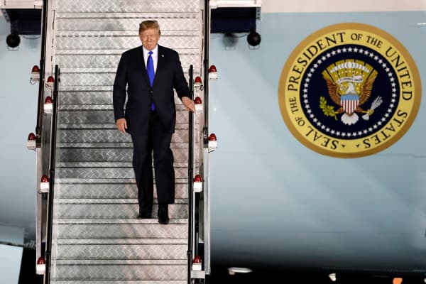 President Donald Trump steps off his plane as he arrives at Paya Lebar Air Base in Singapore, ahead of a summit with North Korean leader Kim Jong Un, June 10, 2018.