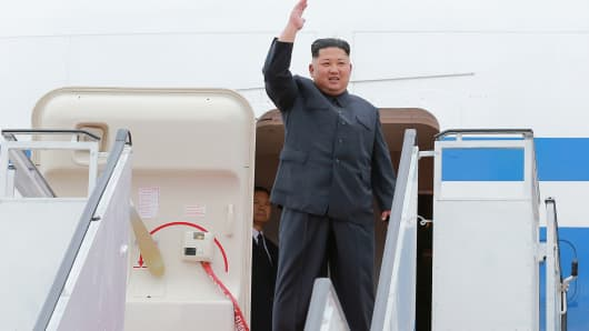 Kim Jong Un waves before departing Pyongyang to Singapore on June 10, 2018.