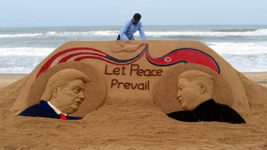 Indian artist Sudarshan Pattnaik, 65, finishes a sand sculpture depicting US President Donald Trump and North Korean leader Kim Jong-un at Puri beach on June 11, 2018, ahead of the US-North Korea summit.