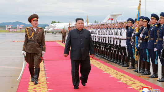 North Korea's leader Kim Jong-un inspects an honor guard ahead of his departure to Singapore in Pyongyang on June 10, 2018.