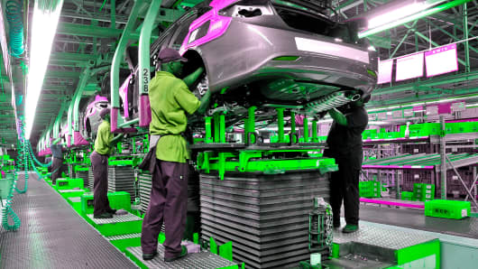Assembly team members assist in the chassis marriage of a 2011 Hyundai Sonata at the Hyundai Motor Manufacturing Alabama (HMMA) plant in Montgomery, Alabama.
