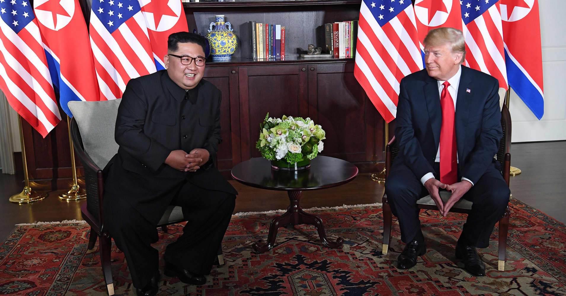 President Donald Trump (R) and North Korea's leader Kim Jong Un (L) sit down for their historic US-North Korea summit, at the Capella Hotel on Sentosa island in Singapore on June 12, 2018.