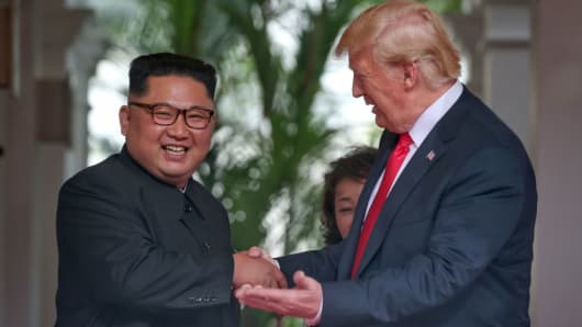 North Korean leader Kim Jong-un shakes hands with U.S. President Donald Trump during their historic U.S.-DPRK summit at the Capella Hotel on Sentosa island on June 12, 2018 in Singapore.