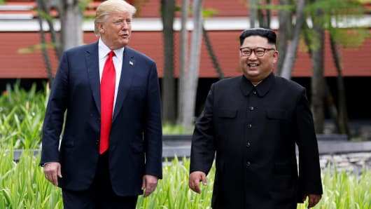 President Donald Trump and North Korean leader Kim Jong Un walk after lunch at the Capella Hotel on Sentosa island in Singapore June 12, 2018.