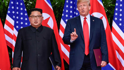 President Donald Trump makes a statement before saying goodbye to North Korea leader Kim Jong Un after their meeting in the Capella Hotel after their working lunch, on Sentosa island in Singapore June 12, 2018.